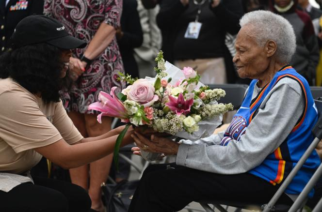 Viola Fletcher, survivor of the Tulsa massacre, receives flowers on May 31, 2021, during a remembrance ceremony.