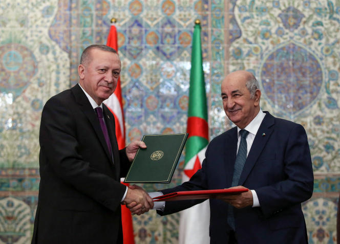 Turkish President Recep Tayyip Erdogan (left) and Algerian President Abdelmadjid Tebboune (right) as they sign bilateral agreements between Turkey and Algeria in Algiers on January 26, 2020.