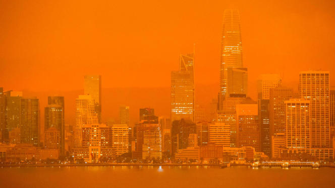 Smoke from fires in northern California makes San Francisco skies glow red in September 2020.