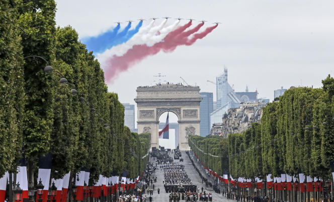 Passage of the Patrouille de France above the Champs-Elysées, during the military parade of the National Day in Paris, July 14, 2019.