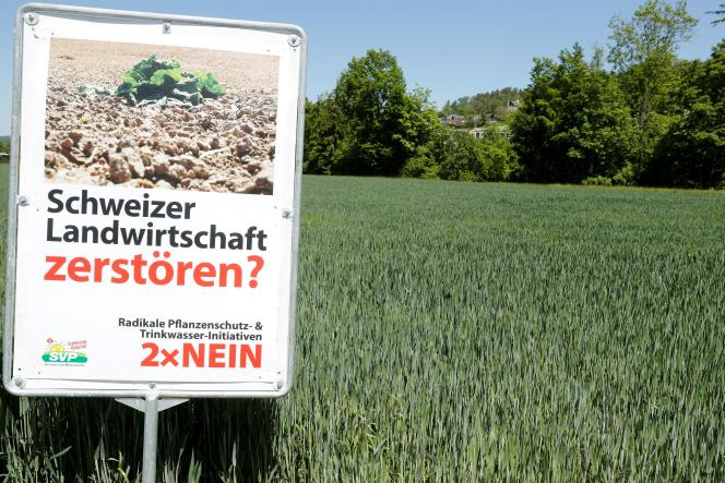 Poster of the conservative and nationalist Democratic Union of the Center party against the environmental initiatives proposed in the June 12 vote.  Near Aesch, Switzerland, June 1, 2021.