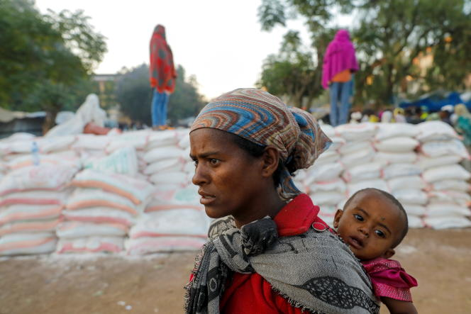 A woman queues for a food aid distribution in Shire, Ethiopia's Tigray region, March 15, 2021.