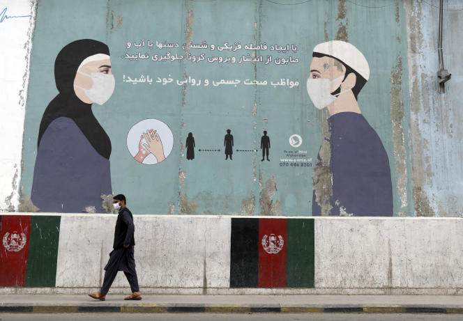 A drawing on the wall of the Afghan Ministry of Public Health in Kabul encourages the use of masks and barrier gestures to prevent the spread of Covid-19 on May 29, 2021.