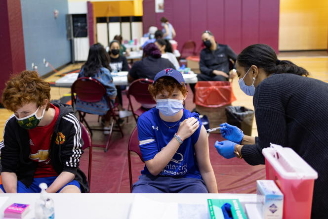 Teenagers get vaccinated against Covid-19 in Philadelphia, Pennsylvania in the United States on May 18, 2021.