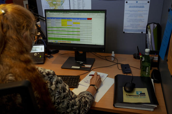 """Stéphanie Morel, volunteer with the """"Allô Prévention Expulsion"""" platform, responds to the many calls that mark the end of the winter break each year.  Usually two per shift, the workforce has been reduced because of the Covid-19.  May 31, 2021, at the headquarters of the Abbé Pierre Foundation, in Paris."""